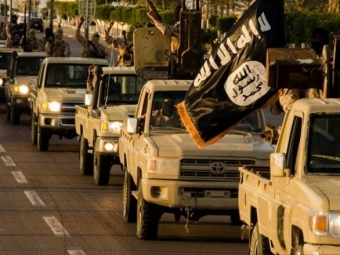 БоевикиИГ вывесили настолбах 20 тел казненных иракцев