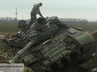Ополченцы отвели технику соспокойных участков фронта— ДНР