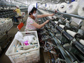 Экономический рост в Китае стал минимальным за два года