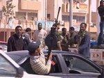 Столкновение противников и сторонников Муамара Каддафи.