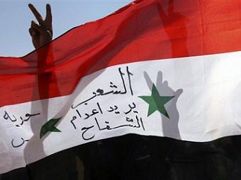 Ливия признала сирийских оппозиционеров законной властью
